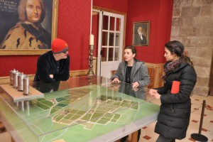 Laetitia of Chateau Haut-Brion shows Chris and Natasha a model of the vineyard