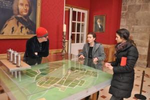 Laetitia of Chateau Haut-Brion shows Chris and Natasha a model of the vineyard